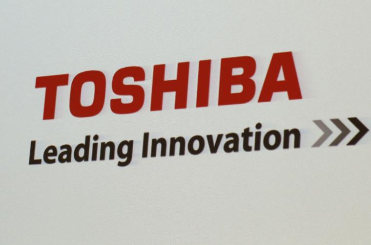Toshiba president steps down amid $20bn buyout bid